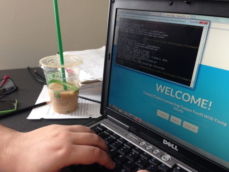 Coding bootcamp student pushes her web application changes to Github